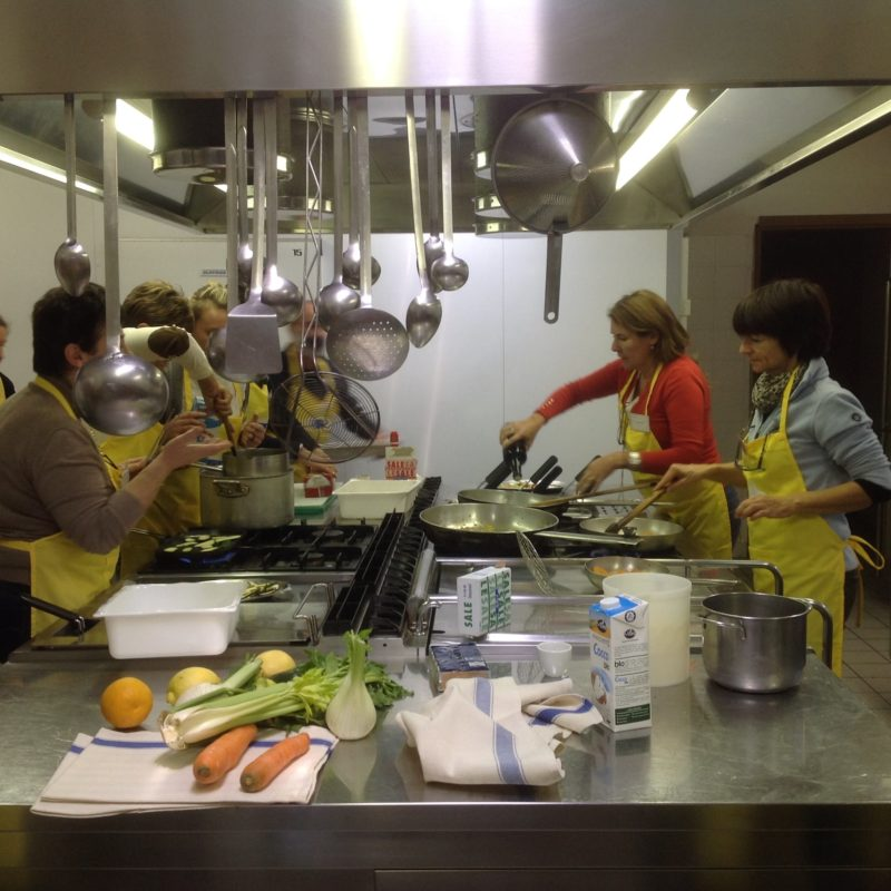 team cooking in limonaia